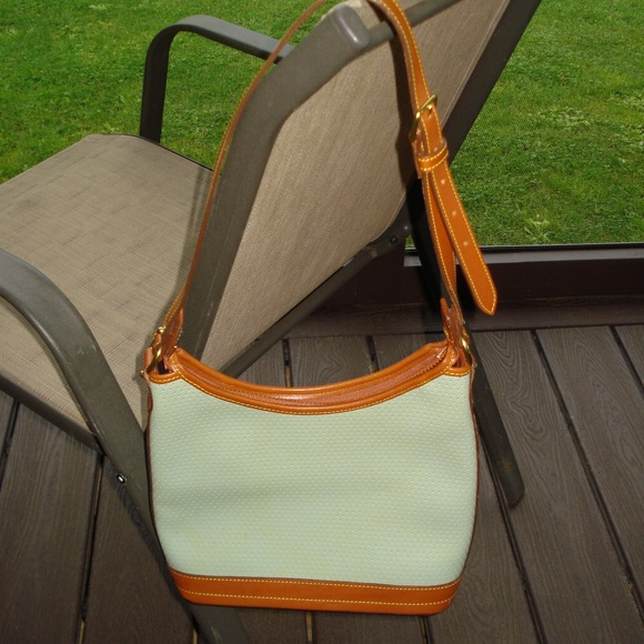 Dooney & Bourke Handbags - Dooney and Bourke pale green purse...NEW